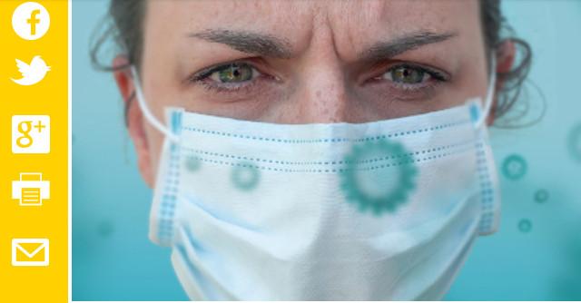Les chiffres de l'Assurance maladie montrent que le pourcentage de professionnels contaminés reconnus pour le covid-19 reste faible. L'image montre une soignante avec un masque et des symboles de coronavirus autour d'elle. Auteur : Pierre Luton, journaliste, rédacteur en chef d'A part entière, le magazine de la Fnath.